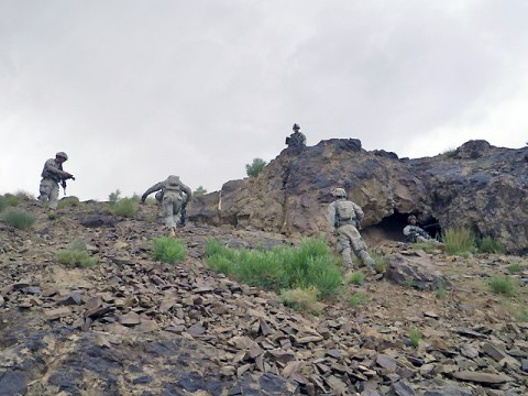 "Soldiers from ""Reapers"", the Mortar Platoon, 1st Battalion, 506th Infantry Regiment, TF Red Currahee, 4th Brigade Combat Team, 101st Airborne Division, TF Currahee, clear a cave and secure the area where they will provide indirect fire support during Operation Red Storm. (Photo by U.S. Army Staff Sgt. Matt Graham, Task Force Currahee Public Affairs)"