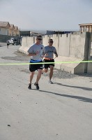 U.S. Army Soldiers from Forward Operating Base Sharana, Afghanistan, race toward the finish line during a 4K run in support of Asian Pacific Heritage Month, May 29th. (Photo by U.S. Army Sgt. Christina Sinders, Task Force Currahee Public Affairs)
