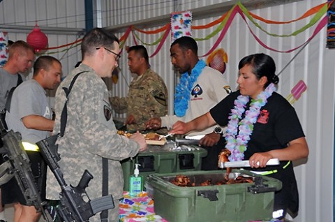 A volunteer for a special event celebrating Asian Pacific Heritage Month at Forward Operating Base Sharana, Afghanistan, serves traditional Korean marinated beef to a U.S. Army Soldier who joined the festivities, May 29th. (Photo by U.S. Army Sgt. Christina Sinders, Task Force Currahee Public Affairs)