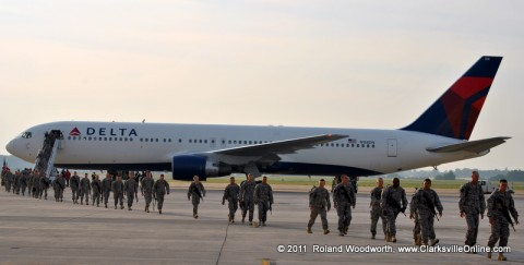 195 soldiers with the 2nd Brigade Combat Team disembark and make their way across the tarmac to Hanger 3 as their family and friends cheer them on