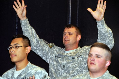 "Sgt. 1st Class Jeff Vanderyt (center), 101st Sustainment Brigade Force Protection NCO, enjoys the music at the brigade's ""Rally Point"" Worship service. The Lifeliners hosted their inaugural Sunday worship and fellowship event at the Lifeliner Lounge. (Photo by Sgt. 1st Class Peter Mayes)"
