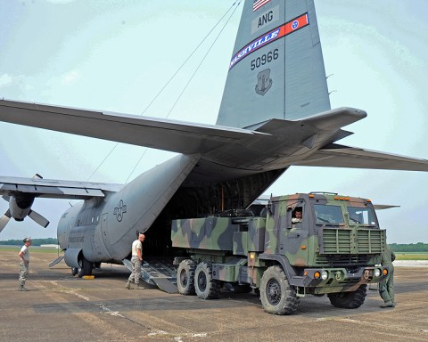 A High Mobility Artillery Rocket System (HIMARS) vehicle is loaded into one of four C-130 aircraft from the 118th Airlift Wing June 4th, as the Tennessee Army National Guard's 1-181st Field Artillery Battalion headed to Fort Chaffee, AR for two weeks of annual training. (Photo by Tech. Sgt. Robin Olsen, Tenn. National Guard Joint Force Headquarters, Public Affairs.)