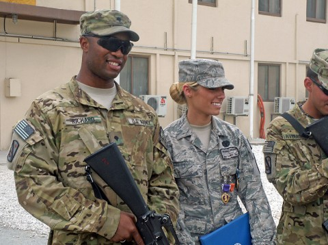 Airman 1st Class Bryenna Brooks, a medic with the 101st Special Troops Battalion, 101st Sustainment Brigade, stands with Spc. Craig Richard Jr., of the 59th Quartermaster Company, 142nd Combat Sustainment Support Battalion, 101st Sust. Bde., after Brooks received four awards, including a Purple Heart Medal. Brooks and Richard were in a vehicle with three other soldiers of the 59th when their vehicle took a rocket propelled-grenade during a resupply convoy mission this past week. (Courtesy Photo)