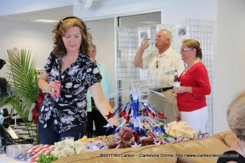 A business after hours guest samples some of Mrs. Roberts fruit and cheeses at Thunder Road Marine