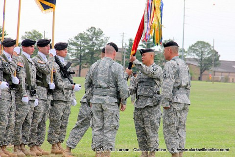 The 3rd Brigade colors are given to outgoing commander Col. Viet Luong.