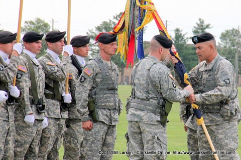 Col. R. J. Lillibridge accepts the Brigade colors from 101st Airborne Division Commander Maj. Gen. John F. Campbell