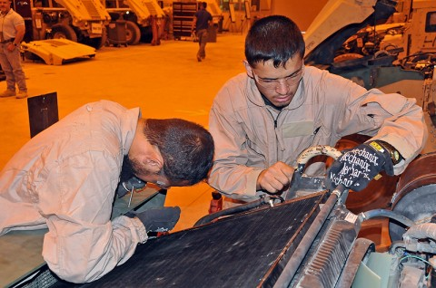 Soldiers with the Afghan National Army work on an M1114 vehicle as part of their maintenance training at Bagram Air Field, Afghanistan. (Photo by Sgt. 1st Class Pete Mayes)