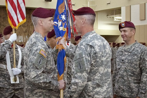 Lt. Col. William T. Golden, IV (left) accepts the 3rd Battalion, 160th Special Operations Aviation Regiment Colors from Col. John W. Thompson, commander, 160th SOAR (A), as he assumes command from Lt. Col. Kirk E. Keepers during a ceremony at Hunter Army Airfield, GA, June 16th, 2011. (160th Special Operations Aviation Regiment courtesy photo.)