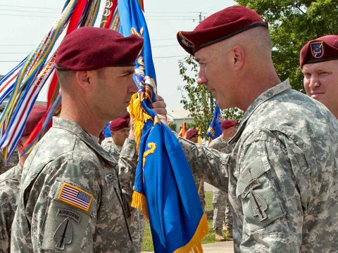 Command Sgt. Maj. Gregory Chambers (left) accepts the 160th Special Operations Aviation Regiment Colors from Col. John Thompson, commander of the 160th Special Operations Aviation Regiment (Airborne), as he assumed responsibility from Command Sgt. Maj. David Leamon during a ceremony at Fort Campbell, KY., on June 8th, 2011. (160th Special Operations Aviation Regiment courtesy photo.)