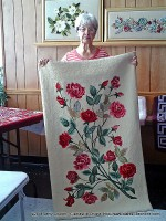 Louise Covington showing off one of her prized hooked rugs