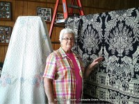Helen Bellar showing off a woven coverlet