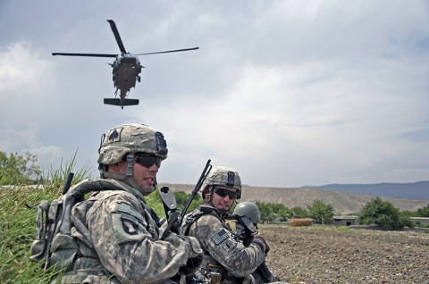 Solders from 1st Squadron, 61st Cavalry Regiment, Task Force Panther, 4th Brigade Combat Team, 101st Airborne Division, attached to 3rd Brigade Combat Team, 25th Infantry Division, Task Force Bronco, patrol the Memlah area, Afghanistan, before a key leader engagement, June 13th. (Spc. Hillary Rustine)