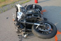 Honda motorcycle collided with the Tahoe, throwing the rider, and continued on without the rider to collided with a Nissan Versa. (Photo by CPD Jim Knoll)