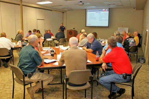 John Sisario, Texas Engineering Extension Service, instructing employees. (CPD-Jim Knoll)