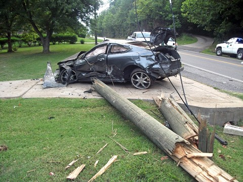 2008 Honda traveling down Dunbar Cave Road, ran off the road, went airborne and collided with a utility pole.