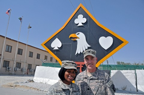 "Pfc. Jasmine Edwards (left) and Lt. Col. Robert Eoff of the 101st Sustainment Brigade pose underneath the brigade ""Deathstar"" in Afghanistan. The two share a unique history Edwards' mother was a squad leader under Eoff's command early in his military career. (Photo by Sgt. 1st Class Peter Mayes)"