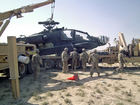 The joint recovery and distribution system is proving successful in vehicle recovery in Afghanistan. Here, soldiers with the 584th Maintainence Company, 142nd Combat Sustainment Support Battalion, 101st Sustainment Brigade, use the JRADS to recover a downed Apache helicopter. (Courtesy Photo)