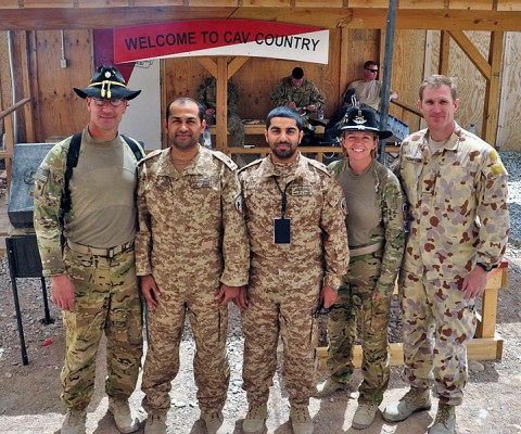 Pilots from Australian, United Arab Emirates and U.S. army aviation task forces pose for a group photo before a combined mission June 30th to destroy insurgent repeater towers in southern Afghanistan. This was the first time the three nations' aviators had worked together in an effort in support of Operation Enduring Freedom. (Photo by Spc. Mario Smith)