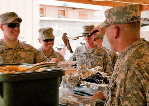 Soldiers from Company B, 1st Battalion, 506th Infantry Regiment, 4th Brigade Combat Team, 101st Airborne Division deployed to Combat Outpost Sar Howza, Paktika Province, Afghanistan, are served lunch by U.S. Army Lt. Col. David Preston, 801st Brigade Support Battalion commander, 4th Brigade Combat Team, 101st Airborne Division, Task Force Currahee, from Belchertown, MA, July 18th as a morale boost eight days after the loss of one of their own, Spc. Rafael Nieves. (Photo by U.S. Army Sgt. Charles Crail, Task Force Blackhawk Public Affairs)