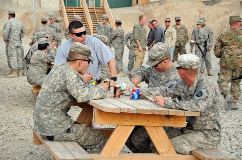 Task Force Currahee Soldiers from 4th Brigade Combat Team, 101st Airborne Division, mingle and enjoy a barbecue to celebrate Independence Day, July 4th, at Forward Operating Base Sharana in Paktika Province, Afghanistan. (Photo by U.S. Army Spc. Kimberly K. Menzies, Task Force Currahee Public Affairs)