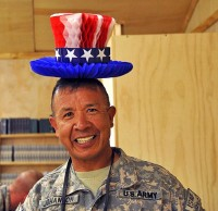 U.S. Army Master Sgt. Jose Johanson, the brigade logistics noncommissioned officer-in-charge from Headquarters and Headquarters Company, 4th Brigade Combat Team, 101st Airborne Division playfully dons a holiday hat decoration in celebration of Independence Day, July 4th. (Photo by U.S. Army Sgt. Luther L. Boothe, Jr., Task Force Currahee Public Affairs)