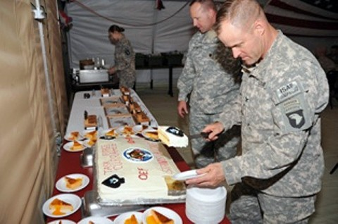 U.S. Army Col. Sean M. Jenkins, the commander of Task Force Currahee, 506th Infantry Regiment, 4th Brigade Combat Team, 101st Airborne Division, cuts and serves the first piece of the birthday cake during a dinner to celebrate the 69th birthday of the 506th Infantry Regiment, July 20th, at Forward Operating Base Sharana in Paktika Province, Afghanistan.  (Photo by U.S. Army Spc. Kimberly K. Menzies, Task Force Currahee Public Affairs)