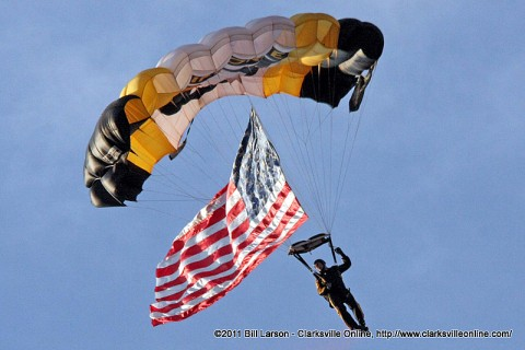 A member of the 101st Airborne Division Parachute Demonstration Team comes in streaming the U. S. Flag
