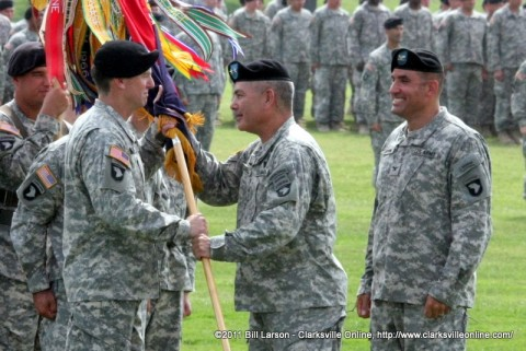 Maj. Gen. John F. Campbell places the 1st Brigade Combat Team colors into the hands of its new Commander Col. Joseph P. McGee