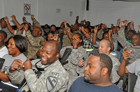 "Chief Warrant Officer 4 Keith Anderson of the 101st Sustainment Brigade Support Operations, shares his words during ""Poetry Night"" at the Morale, Welfare and Recreation Center at Bagram Airfield, Afghanistan. The event offers service members a creative outlet for relaxation while deployed in a combat environment. (Photo by Sgt. 1st Class Peter Mayes)"