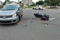 A 2008 Nissan Versa pulled out in front of a 2009 Kawasaki motorcycle causing the motorcycle to collide with the car. (Photo by CPD Officer Derrick Cronk)