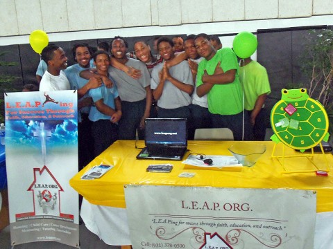 Some of the youth from the Woodland Hills Youth Development Center stand behind the LEAP Organization booth at the Woodland Hills Career Fair (Photo by Richard Garrett)