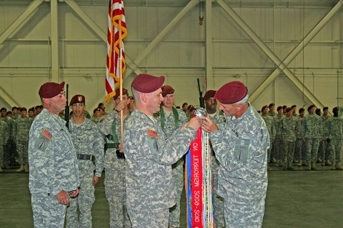 Lt. Col. Phil Ryan (left), commander of 2nd Battalion, 160th Special Operations Aviation Regiment (Airborne), and Col. John Thompson, SOAR commander, secure the battalion's first Meritorious Unit Commendation streamer to the unit colors during a ceremony at Fort Campbell, KY, August 15th, 2011. (160th Special Operations Aviation Regiment photo)