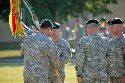 Col. Scott Brower accepts the 5th Special Forces Group (Airborne) Colors from Brig. Gen. Edward Reeder, commander, U.S. Army Special Forces Command, as he assumes command from Col. Mark Mitchell during a ceremony at Fort Campbell, KY, August 12th, 2011. (Photo by 5th Special Forces Group (Airborne) Public Affairs)