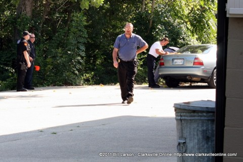 Clarksville Police Department Investigators processing the victims car at the crime scene