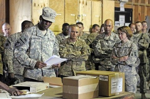Chief Warrant Officer 4 Jerry Scarborough, of support operations, 101st Sustainment Brigade, shows leaders of the 101st Sust. Bde. the process of receiving goods at the Bagram Supply Support Agency. (Photo by Spc. Michael Vanpool)