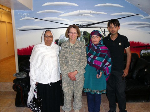 Chap. (Maj.) Tammie Crews, the brigade chaplain for the 101st Sustainment Brigade, stands with a local mother and daughter who work to progress gender equality in Afghanistan. The mother is involved in politics and the daughter is a school principal. Crews gave them around 60 donated boxes from several organization across the U.S. to distribute to the young girls at a local school in Kabul. (Courtesy Photo)