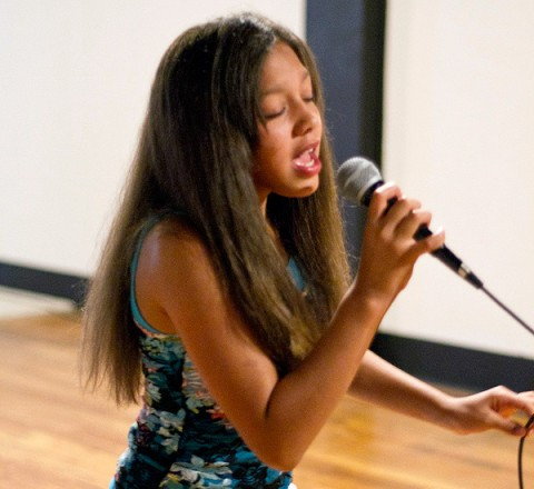 """Madison Fisher, 11, performs for the judges during auditions for """"Gateway To Stardom"""", held last Saturday at Gateway Realty Investment Group."""