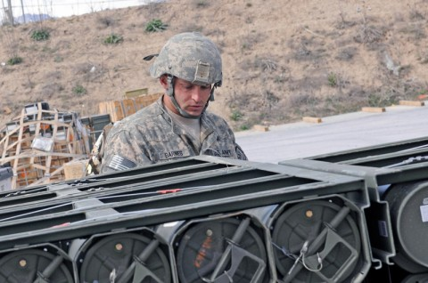 Spc. Frank Barnes, an ammunition specialist for the 592nd Ordnance Company, a reserve unit from Billings, Mont., attached to the 142nd Combat Sustainment Support Battlalion, 101st Sustainment Brigade, inspects an Air Force pallet with ordnance preparing for an air delivery to outlying forward operating bases. All ammunition destined for FOBs in Northern, Central and Eastern Afghanistan passes through the 592nd. (Photo by Spc. Michael Vanpool)