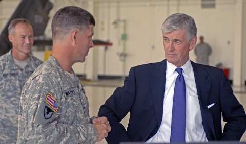 Secretary of the Army John McHugh gets a brief on the new UH-60L Black Hawk helicopter from Lt. Col. Christopher Waters, 5th Battalion commander, 101st Combat Aviation Brigade, 101st Airborne Division (Air Assault), at Fort Campbell, August 11th. (Photo by Sgt. Scott Davis)
