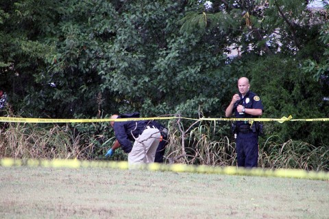 Clarksville Police investigate the scene where the deceased male body was found. (Photo by CPD)