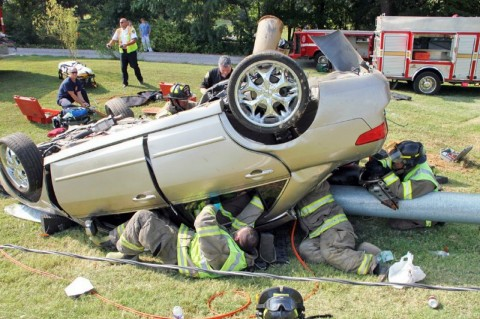 Extricating 2 year old. (Photo by CPD – Jim Knoll)