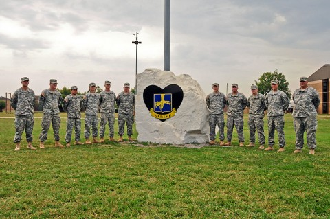 Soldiers with 2nd Brigade Combat Team, 101st Airborne Division (Air Assault), who served through four tours, stand beside Strike Rock, located near brigade headquarters at Fort Campbell, KY, earlier this month. The Soldiers were recognized during a ceremony for their multiple deployments in support of Strike Brigade's missions. (U.S. Army Photo By Sgt. Joe Padula, PAO, 2nd BCT, 101st Abn. Div.)