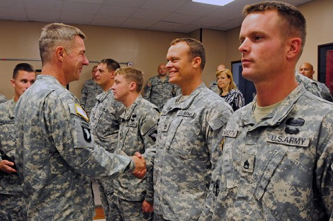 Maj. Gen. James McConville, commander, 101st Airborne Division (Air Assault), shakes the hand of Sgt. 1st Class Christopher Dorsey with the 101st's 2nd Brigade Combat Team who has deployed with Strike four separate times. McConville addressed the Strike Soldiers who served through four deployments, during a ceremony at Fort Campbell, KY, earlier this month. (U.S. Army Photo By Sgt. Joe Padula, PAO, 2nd BCT, 101st Abn. Div.)