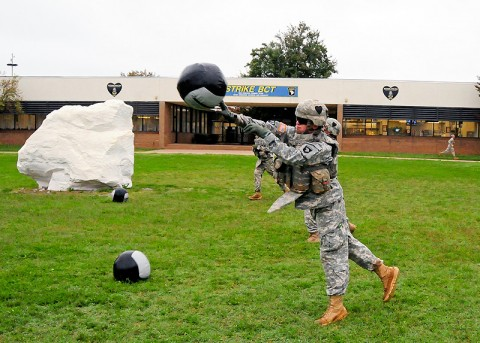 Spc. Darren Snyder, a rifleman with Company C, 2nd Battalion, 502nd Infantry Regiment, 2nd brigade Combat Team, 101st Airborne Division (Air Assault), throws a medicine ball across Strike Field during the monthly Iron Strike Challenge at Fort Campbell, KY, September 15th. Snyder and his teammates won first place out of six competing teams, one from each battalion within Strike Brigade. (U.S. Army Photo By Spc. Shawn Denham, PAO, 2nd BCT, 101st Abn. Div.)
