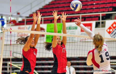 Senior Kayla Grantham and sophomore Lauren Henderson attempt to stop SIUE's Julia Whitfield, Saturday, SIUE won a five-set contest at the Dunn Center. APSU Volleyball. (Courtesy: Cidnie Sydney-Brewington/APSU)