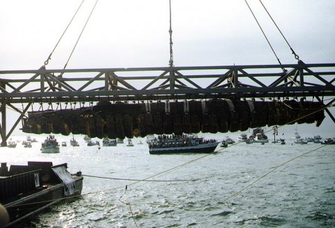 H. L. Hunley, suspended from a crane during its recovery from Charleston Harbor, August 8th, 2000. (Photograph from the U.S. Naval Historical Center.)