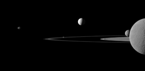 NASA's Cassini spacecraft captures five of Saturn's moons in one image: Janus, Pandora, Enceladus, Mimas and Rhea. This view looks toward the northern, sunlit side of the rings from just above the ringplane. Rhea is closest to Cassini here. The rings are beyond Rhea and Mimas. Enceladus is beyond the rings. (Image credit: NASA/JPL-Caltech/Space Science Institute)