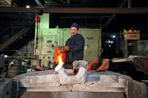 "As part of reproducing a section of the Civil War submarine H.L. Hunley's conning tower, Larry Hale of Clarksville Foundry melts iron for a casting that was used in the National Geographic Channel's special ""Secret Weapon of the Confederacy,"" which premiers Thursday, September 15th."