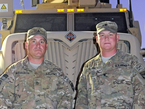Staff Sgt. James McCullough, a convoy commander with the 1138th Transportation Company, a Missouri National Guard unit attached to the 142nd Combat Sustainment Support Battalion, 101st Sustainment Brigade, stands with his son, Spc. Ryan McCullough. Both father and son provide convoy security and resupply service members throughout eastern Afghanistan. (Photo by Spc. Michael Vanpool)