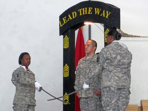 Sgt. Socorro Garcia, an administrative non-commissioned officer with the 101st Sustainment Brigade, prepares to step through the archway of the newly promoted non-commissioned officers during a ceremony at Bagram Air Field, Afghanistan. (Photo by Sgt. 1st Class Mary Perez)